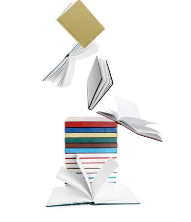 Flying books on white background