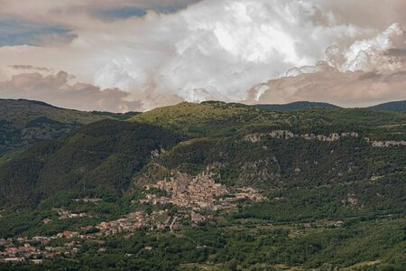 Panorama of Pesche, village in the province of Isernia, in Molise, perched along the steep slopes of Mount San Marco, a white spot against the green of the mountain and the gray of the stones.
