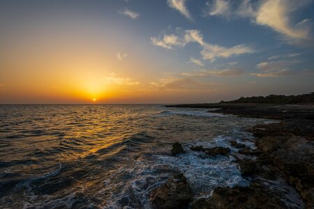 Adriatic sea. Ostuni, Puglia. Sunrise. Renowned seaside resort located in the heart of Salento. This stretch of coast is punctuated by a series of rocky beaches