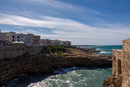 Polignano a mare. It is a municipality in the metropolitan city of Bari in Puglia. The oldest part of the town stands on a rocky outcrop overlooking the Adriatic Sea.