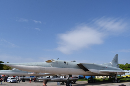 Ukraine, Kiev - May 2, 2017: Tu-22M (for NATO codification Backfire) long-range supersonic missile bomber with variable wing and its cruise missiles, State Aviation Museum, Old Car Land Festival Spring-2017