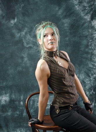 Photo session of the pretty young blonde girl with green hair in the steampunk style Stock Photo - 10794107