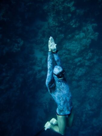 Freediver rises up from the depth of the Blue Hole in Dahab, Egypt photo