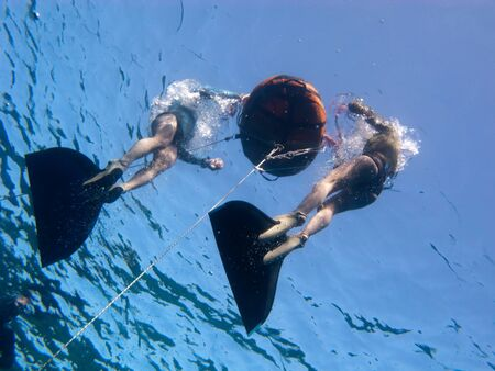 Two freedivers prepare their equipment for the training Stock Photo
