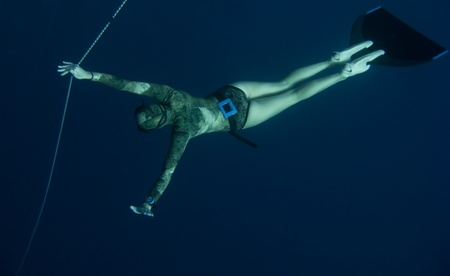 Safety freediver is waiting for his diving partner in Blue Hole, Dahab, Egypt