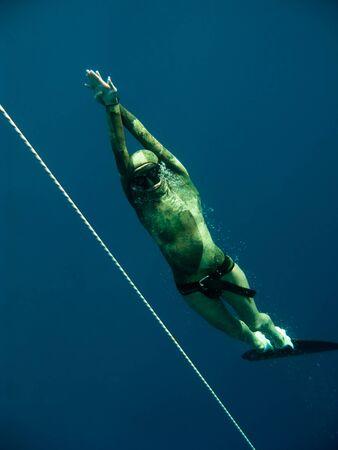 dahab: Freediver rises up near the safety rope in Blue Hole, Dahab, Egypt
