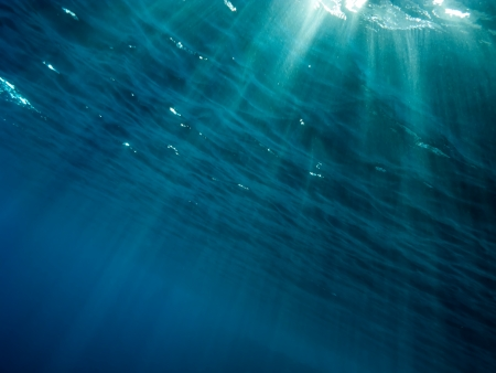 The underwater picture with the rays of light from the surface to depth photo