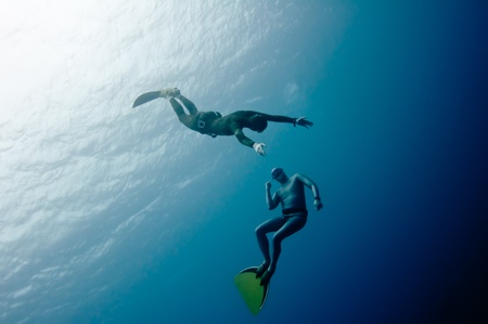 Two freedivers have hun in the depth of Red Sea Stock Photo - 10774187