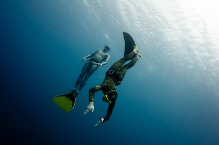 Two freedivers have hun in the depth of Red Sea Stock Photo