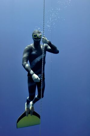 Freediver trains his deconcentration and relaxation technique while ascending