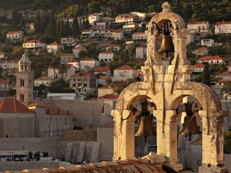 The belfry at the Dubrovnik city center, surronded by red towns roofs