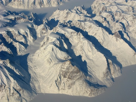 Aerial view of the Greenland with mountains, ocean fields, rocks...