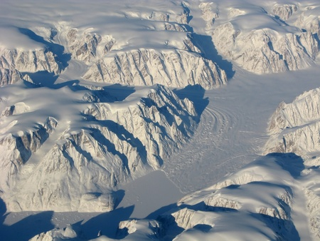 Aerial view of the Greenland with glacier, mountains, ocean fields, rocks...