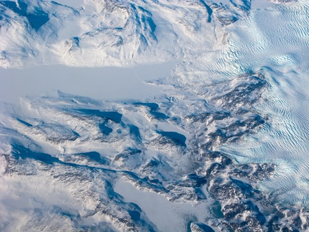 Aerial view of the Greenland with mountain, snow river and waves