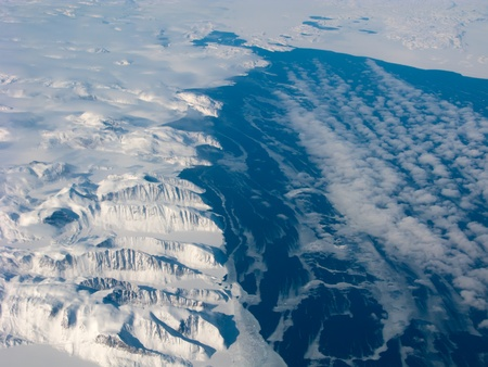Aerial view of the Greenland gulf with mountain and ocean