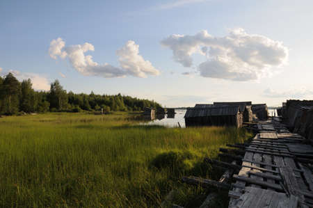 The picture shows abandoned and broken slip docs in a small settlement in Russias Karelia region