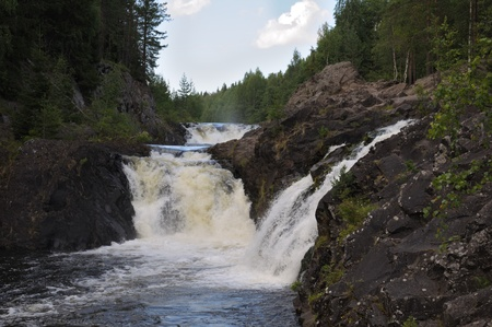 falling tide: This picture shows Kivach - the most powerfull waterfall in Karelia region (approximately 12 meters)