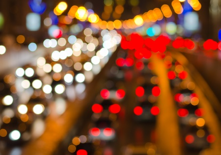 city lights: Abstract blurred colorful circles (defocused night freeway scene), suitable as a background