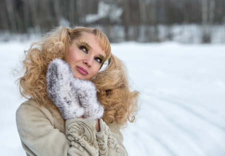 cilia: Giddy young woman with exaggerated cilia in a winter field Stock Photo