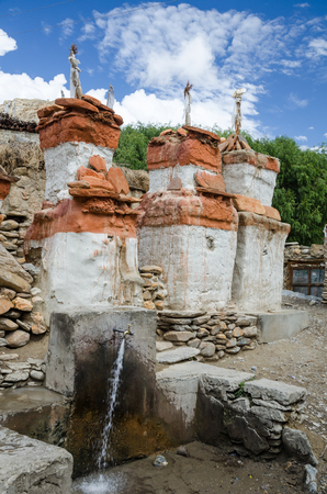local supply: Chortens and flowing water at water supply system of Chele village, Upper Mustang