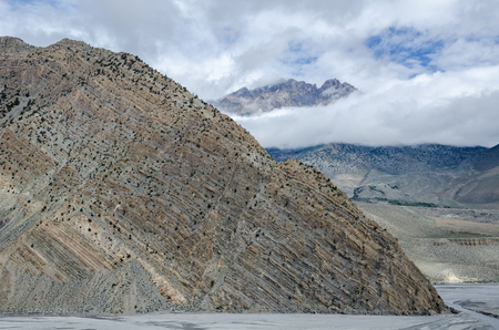 clearly: Clearly visible layered geological structure of Nepalese mountain near Jomsom town. Nepal.