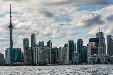 toronto: A small airplane flies above the skyscrapers and television tower of Old Toronto. View from Algonquin island, Canada Stock Photo
