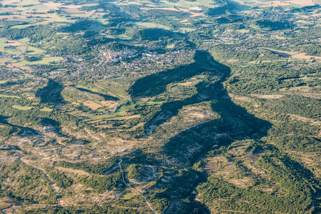 flexure: Mid-air view of green hills and cultivated land near Forcalquier city, Provence