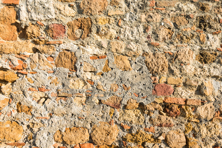 Close up view of an aged textured plastered stone wall