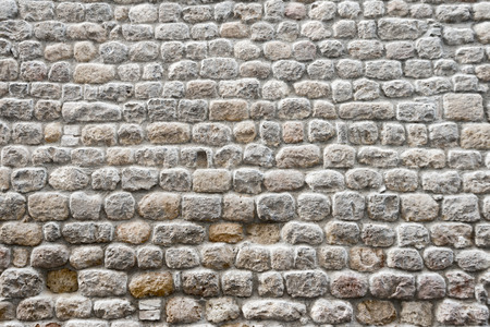 Close up view of a textured ancient stone wall of a historical building Stock Photo