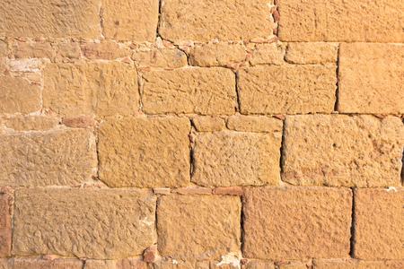 Close up view of an ancient flat textured brick wall