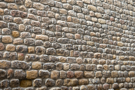 Biased ancient stone wall of a historical building, suitable as a textured background Stock Photo