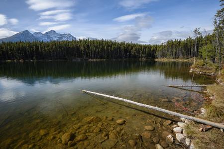 Underwater stones and Rocky Mountains near the Herbert Lake Stock Photo