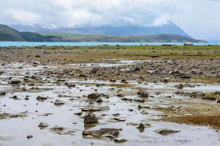 Shallow water at Lake Tekapo reveals a lot of small stones