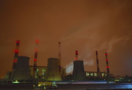 Power plant in the big city at winter time. Red night sky. Moscow. Scanned film 60x40mm.