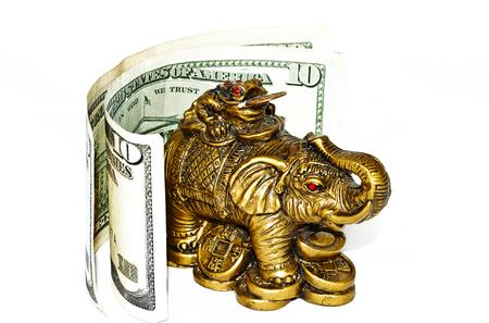 Bronze elephant with bills on white background photo