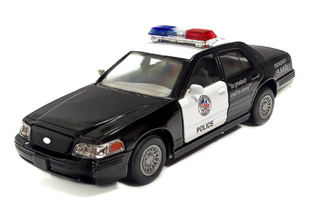 one object: The field officer the car of the USA on a white background.Toy police car. Indoors. Horizontally. Color. Car model. Metal. One object. Shadow. Stock Photo