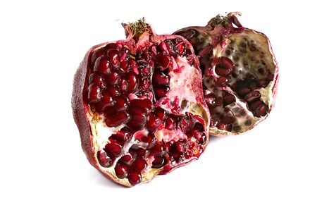 two and a half: Two half of pomegranate on a white background.