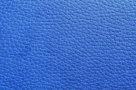 파란색의 스탬프와 모조 가죽의 질감. 가로 형식입니다. 실내. 색깔. 사진. 스톡 콘텐츠