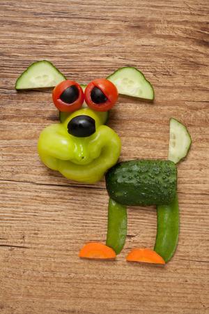aliments droles: Vegetable dog on wooden background Banque d'images