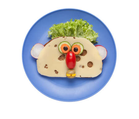 aliments droles: Funny face made of food on blue plate
