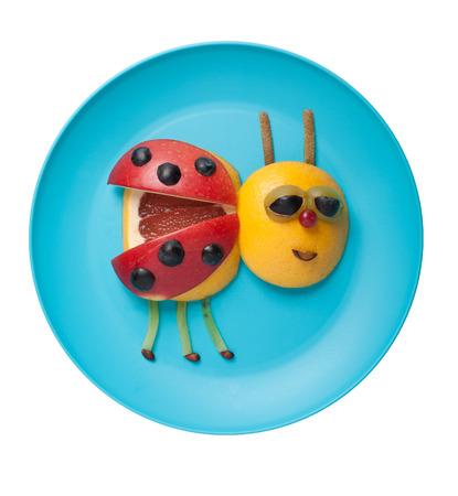 ladybird: Ladybird made of fruits on plate