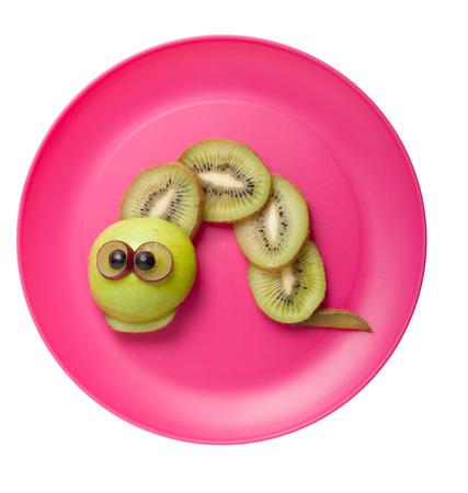 children caterpillar: Caterpillar made of fruits on pink plate Stock Photo