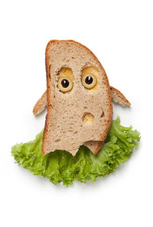 wraith: Halloween ghost made of bread and vegetables on white background