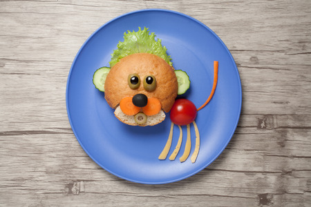 Baby lion created of bread and vegetables