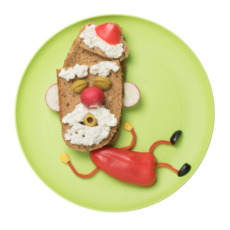 Happy Santa made with vegetables and bread on plate Stock Photo