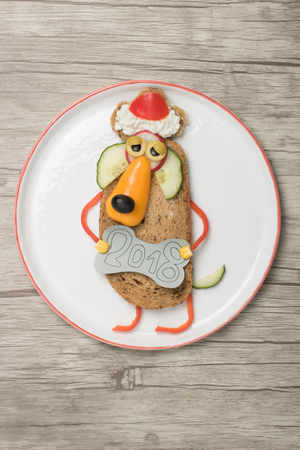 Sandwich dog in Santa Hat and New Year sign