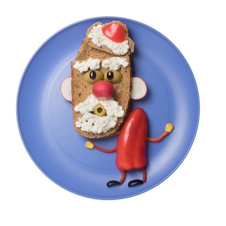 Santa made with vegetables and bread on plate Stock Photo