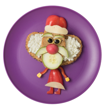 Santa made with vegetables on purple plate