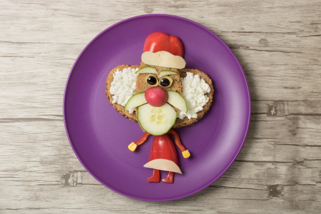 Funny sandwich Santa on plate and board