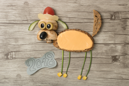Dog made with bread and cheese ready for New Year celebration Stock Photo